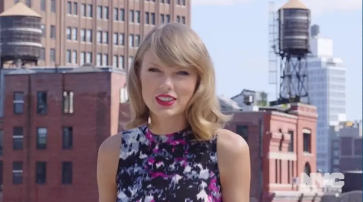 NYC Tourism Ambassador Taylor Swift Standing On an NYC Roof