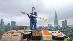 EDITORIAL USE ONLY Edward Hopkins interacts with the worldÕs biggest bento box, which has been commissioned by Groupon to celebrate the capitalÕs love of sushi, London. PRESS ASSOCIATION Photo. Issue date: Wednesday September 21, 2016. Research by Groupon found that sushi is a favourite dish of residents in the capital, and tops the list for the City of London. The platter, which comprises of 350 kilos of rice and 6 sides of salmon, took 4 people, 4 days to complete. Photo credit should read: Anthony Upton/PA Wire