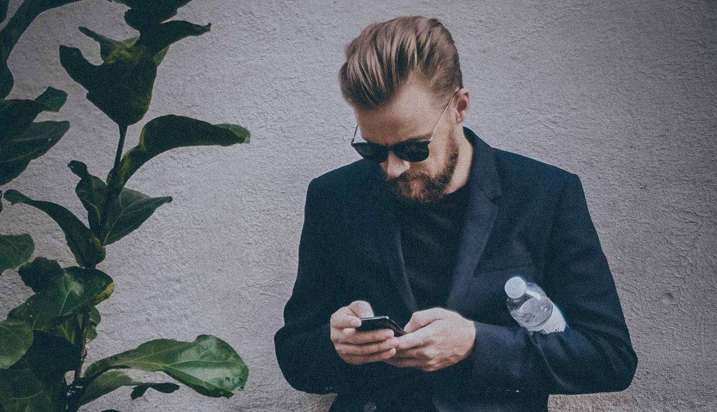 Man using phone while waiting for date
