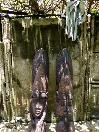 Carved African masks with pants