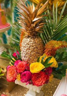 Golden Pineapple with bright florals and palm leaves. Very easy to DIY!