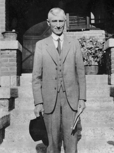 Brown Craig Patterson [1865-1953]. The picture shows him standing on the steps of his home in Tengxian, probably in the mid-1930s.