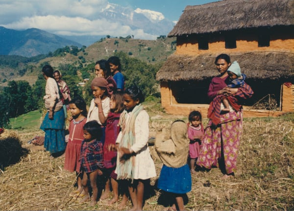 Nepali Family by their house