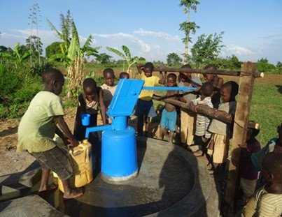 Children draw water from new well