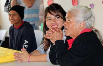 Students from a childrens home visiting a retirement home