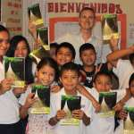 Giving Bibles to the students at the Precious Moments School and Orphanage