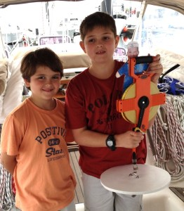 16. Round Hill Elementary School students Harrison & Ryan with Secchi Disk. They and their mom and dad visited Joyful in Key West before the start of the BPO.
