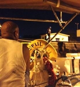 34. Land side lock worker walked Joyful's line forward into the second Atlantic (Gatun) lock as she motored forward rafted with Aventura and the catamaran.