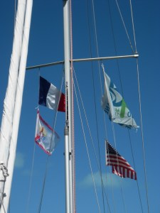 5. Joyful's flags in Bora Bora.  The USA ensign flew from Joyful's backstay, the Blue Planet Odyssey flag few from her port spreader halyard, and the French and French Polynesia flags flew from her starboard spreader halyard.