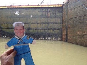 83. Flat Mr. Davis and birds were near the upper Miraflores lock doors as water level lowers.