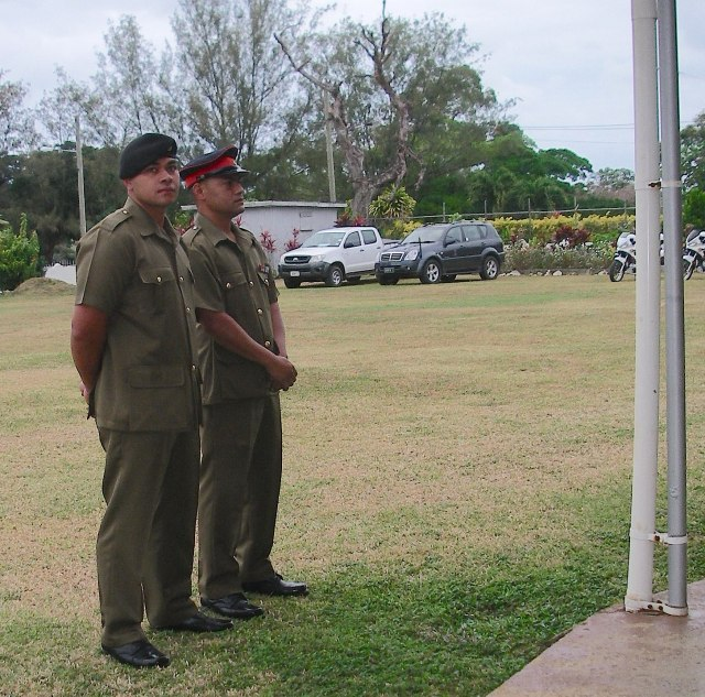 4. Brave Tongan Army guards protect the King and Queen of Tonga while in church and everywhere they go