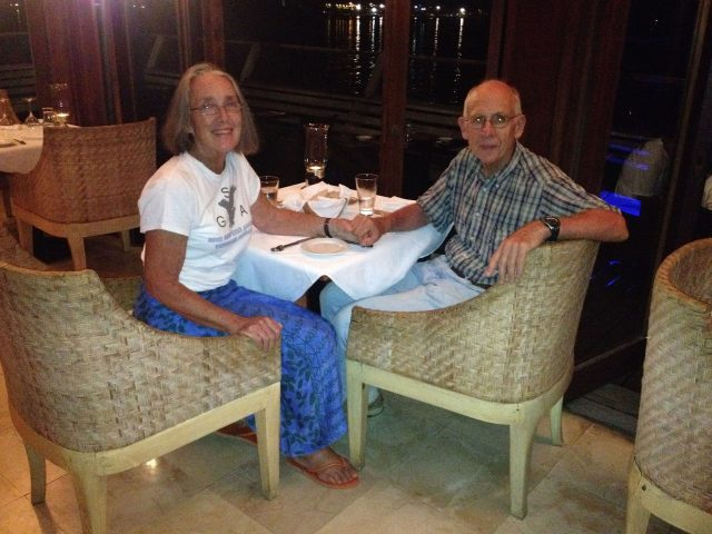 40. Jeff and Anne dining at the MaiKai in Bora Bora.  Anne is proudly wearing a tee shirt from one of the three American schools that partnered with Joyful in the Blue Planet Odyssey