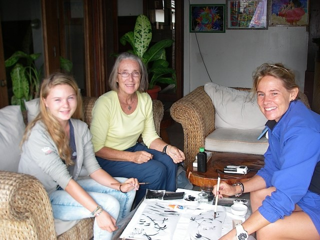 55. Anne taught fellow sailing missionaries, Beatrice and Gabriella, Chinese brush painting in an art ministry workshop in Bora Bora.