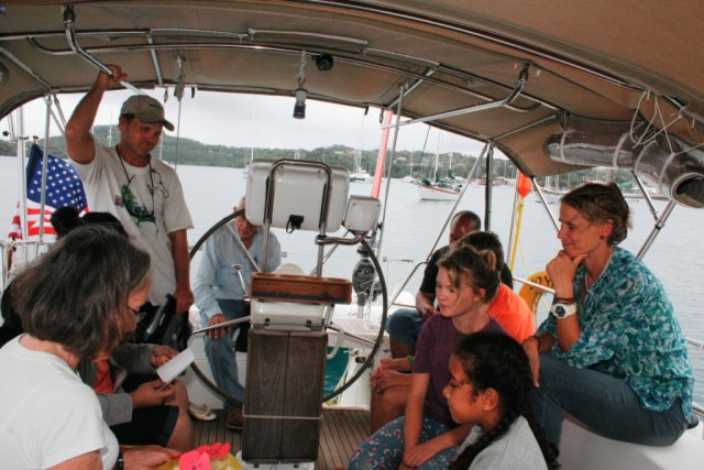 55. Anne unwrapping birthday presents on Joyful from local Tongans and sailing missionary friends