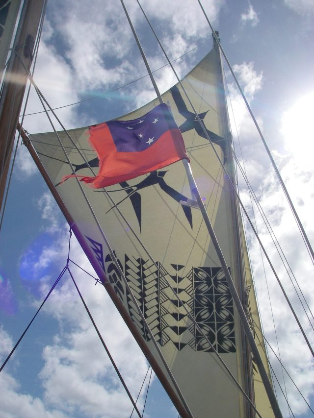 81. The Samoa ensign flies proudly from a stay on the traditional vaka