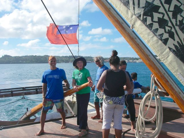 86. Anne shared the vaka's tiller with a Tongan sailor. It took lots of strength to handle the tiller of the craft, especially when the boat had to be skulled during certain maneouvers