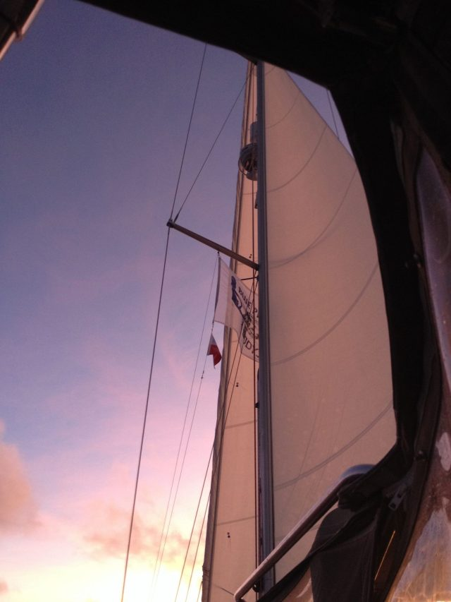 9. Joyful's white sails reflected the varied colors of the sunset.  We always looked forward to seeing sunsets from Joyful, whether at sea or on land.  They were always a delight to see