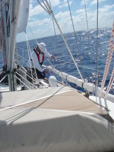 24. Flat Mr. Davis checks to see if the stanchions are securily fastened on Joyful's decks. They hold the life lines onto the boat