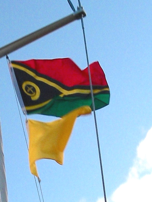 1-joyfuls-vanuatu-courtesy-and-yellow-quarantine-flags-flew-from-her-starboard-flag-halyard-as-we-approached-efate-vanuatu-she-had-to-fly-the-quarantine-flag-until-she-cleared-into-the-country-th