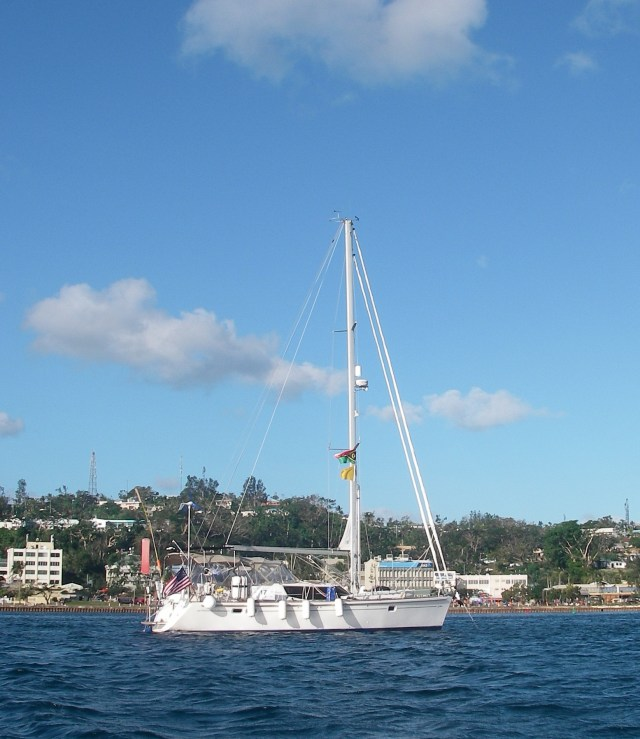 3-joyful-flew-her-yellow-quarantine-flag-under-her-vanuatu-courtesy-flag-while-anchored-in-the-customs-anchorage-we-kept-her-fenders-out-in-case-the-customs-boat-came-alongside-but-they-never-did