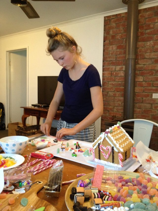 126. Fourteen year old Gabriella thoughtfully constructing her gingerbread house she will kindly give to the Phillip Island Police Station