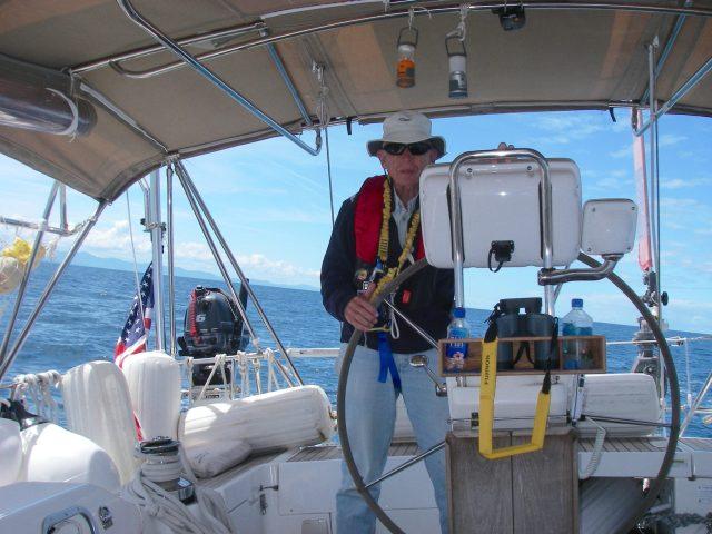 61. Jeff at Joyful's helm on the east coast of Australia