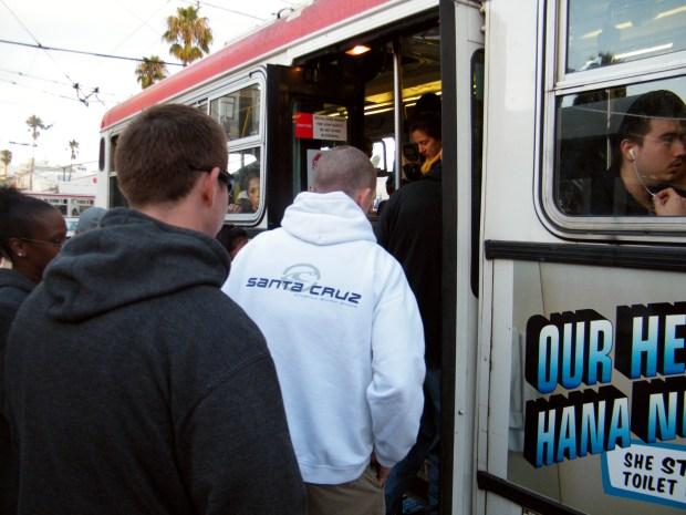 Undercover cops enter the 14-Mission bus.