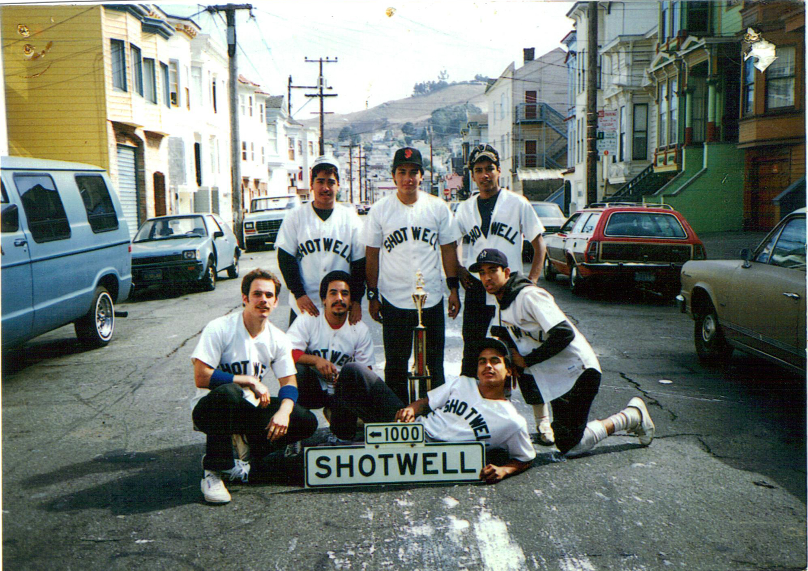 Shotwell softball team, Frank Peña kneeling on right in the early '80s. (Courtesy of Louis Lucero)