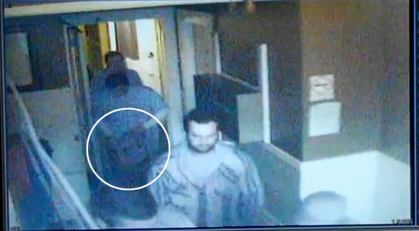 Video released today by the Office of the Public Defender shows what they claim to be officer Ricardo Guerrero leaving Julian Hotel with a bag containing a laptop.
