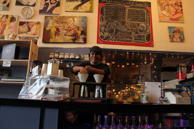 Enrique Ramirez is busy working at Mutiny Cafe