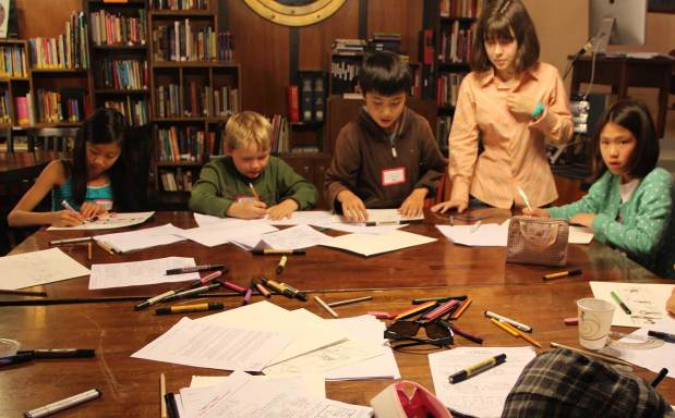 Emma Capps helps students finalize their comic book ideas and storyboards. Photo by Erica Hellerstein.
