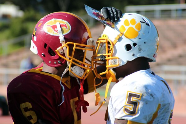 Demetrius Williams of Lincoln High (right) talks to Antoine Porter after the game.