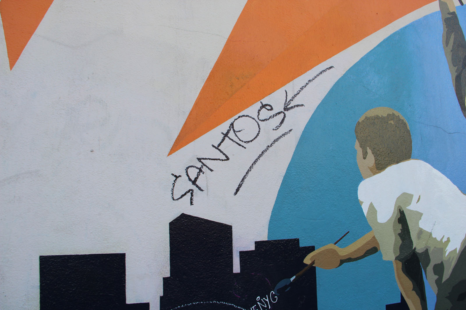 "a mural of a boy painting with the graffitied word, ""santos"" above"