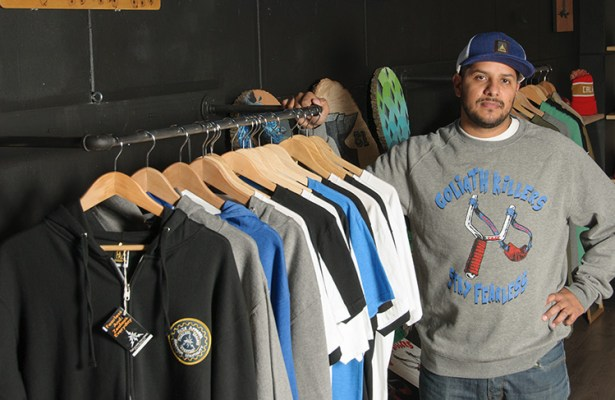 "Faze partner Herbert Gracia wears a ""Goliath Killers"" sweater."