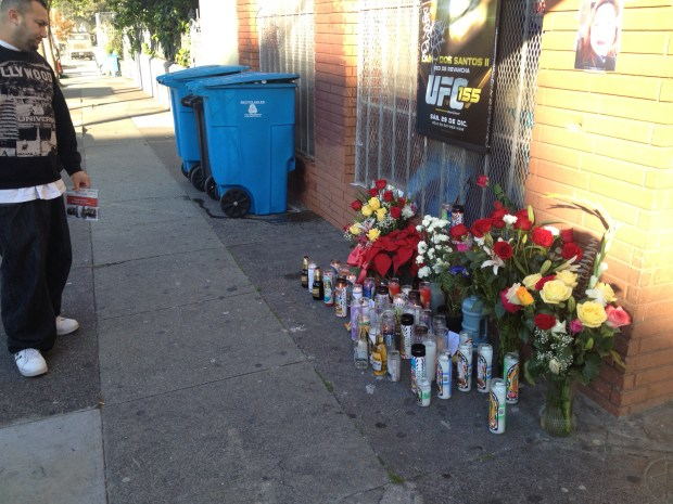 A vigil set up outside of Muzio's Wine Liquor on 21st Street and South Van Ness Aveunue after a car collision killed two people. Photo by Carly Nairn.