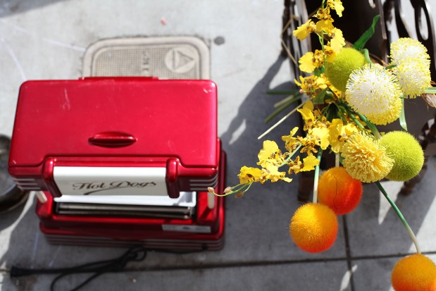 Flowers and a hot dog machine seen on 18th Street near Guerrero Street.