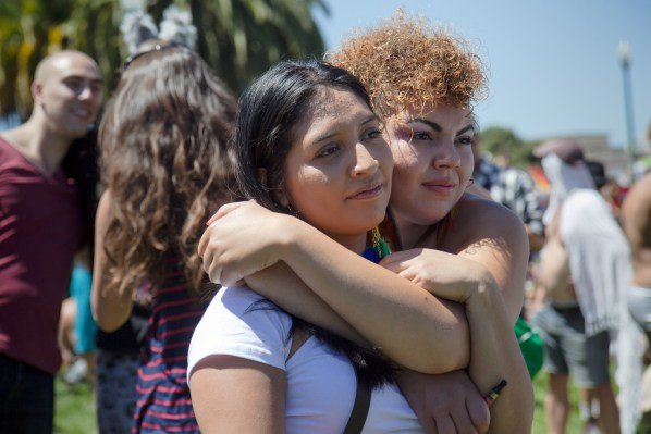 Two women hold at Dolores Park on Saturday.