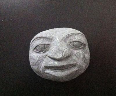 Close-up of a Bini face.