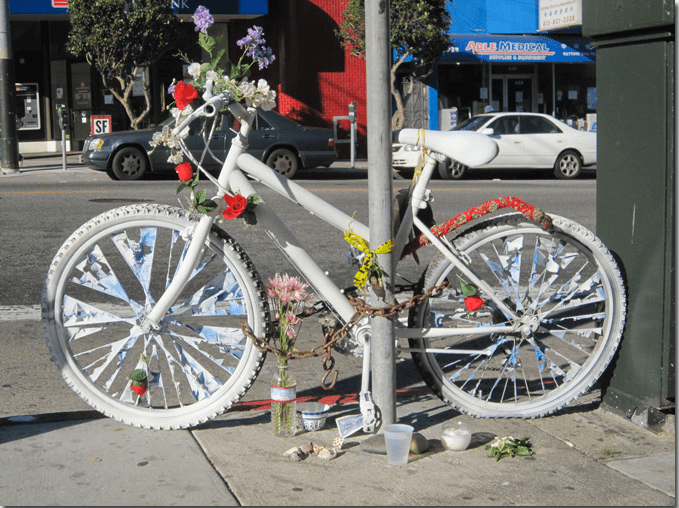 Ghost bike honoring Derek Allen, 22, who was killed by a bus on 6th Avenue and Clementin October 2010. Photo via Richmondsfblog