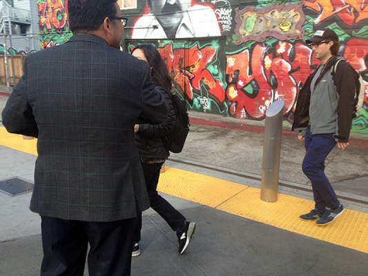 Campos greeting commuters this morning. Photo by Lydia Chávez