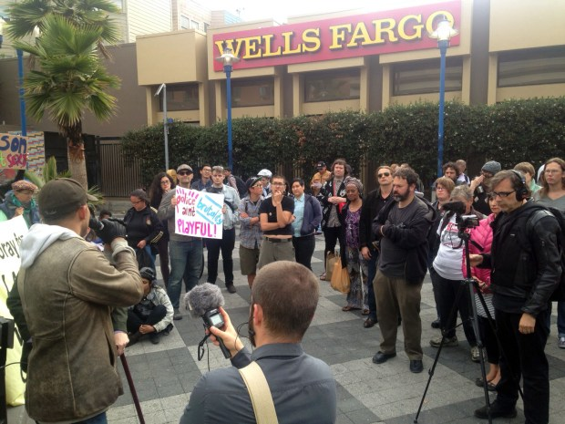 A crowd of about 50 people attended a press conference denouncing police actions on Saturday when three activists were arrested.