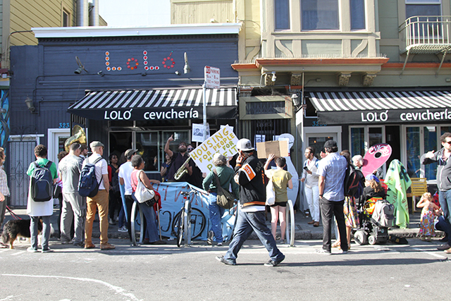The crowd of about 30 people and protesters gathered at 22nd and Bartlett, outside Dattani's building. Photo by Andrea Valencia