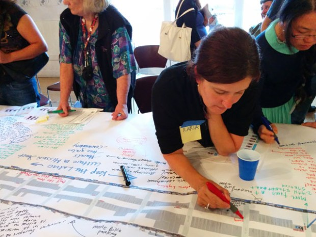 Project manager Ilaria Salvadori discusses input from the community on a map of Mission Street. Photo by Laura Wenus.