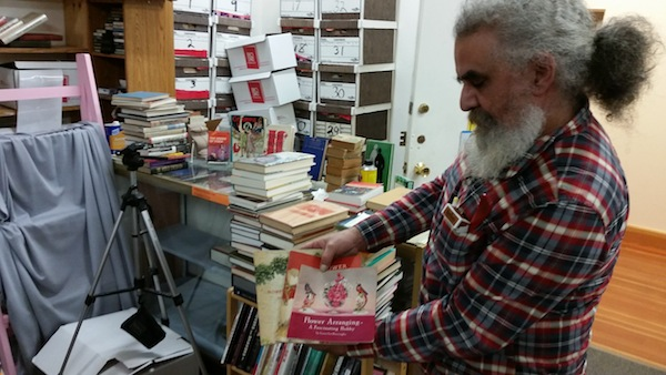 Joe Marchione shows off his collection at Valhalla Books. Photo by Daniel Hirsch.