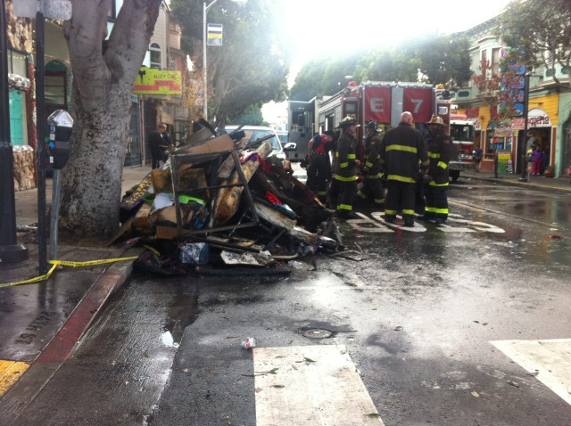 This is one of the piles of charred debris that the firefighters pulled out of the apartment. They have remained on the street since the fire, awaiting to be removed by the property owner. Photo by Andrea Valencia