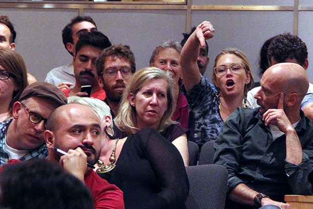 A member of the public voices her opposition to Lee's closing statements. Photo by Laura Wenus