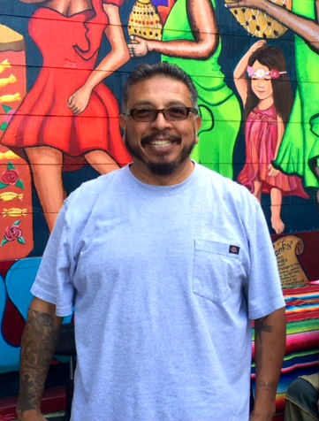 "Carlos ""Kookie"" Gonzalez is the artist behind the ""Chata"" mural. Photo by Laura Waxmann"
