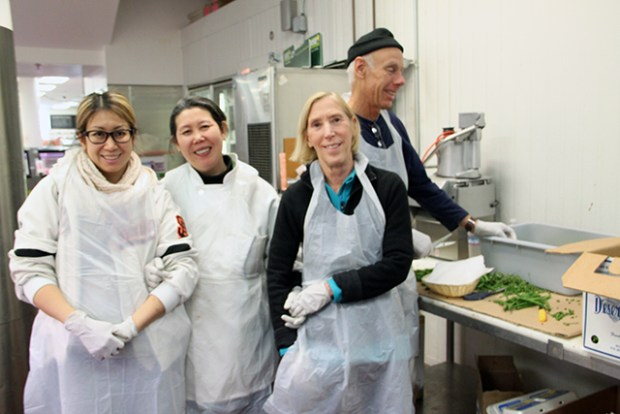 Duc Loi owner Amanda Ngo (second from left) and her team of volunteers had a busy week preparing for the supermarket's 7th annual Thanksgiving feast.  She expects to feed a thousand people in need this year. Photo by Laura Waxmann