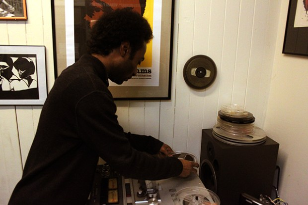 Nathaniel Moore loads up a tape from the Freedom Archives. Photo by Laura Wenus