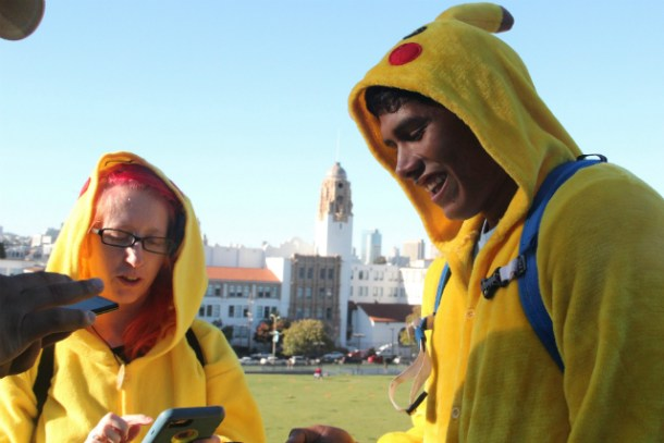 Right to left, Willie Diaz and Layla Skramstad in Pikachu costumes for the July 20, 2016, Pokemon Go crawl event. Photo by Joe Rivano Barros.